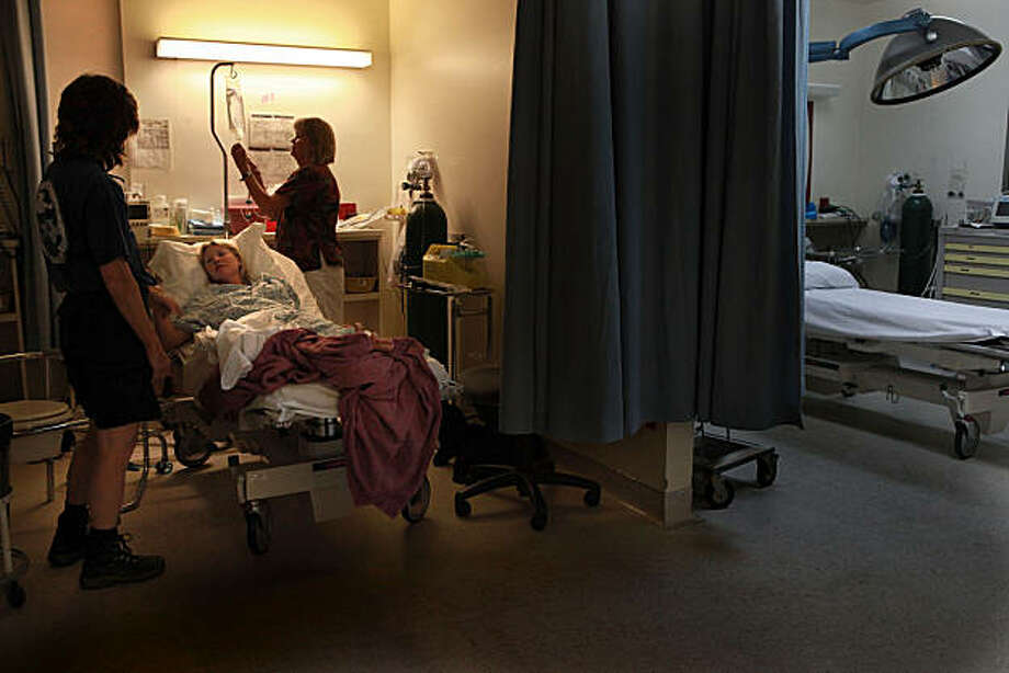 Tiffany Ogg, 31 years old, who's lived in the valley since April, being treated for dehydration at the trauma center in Yosemite Valley Medical Clinic in Yosemite Valley, Calif., on Monday September 13, 2010.   She hiked almost five miles into the Half Dome trail when she fell sick, and was brought into the medical center by horse, helicopter, and ambulance. Photo: Liz Hafalia, The Chronicle