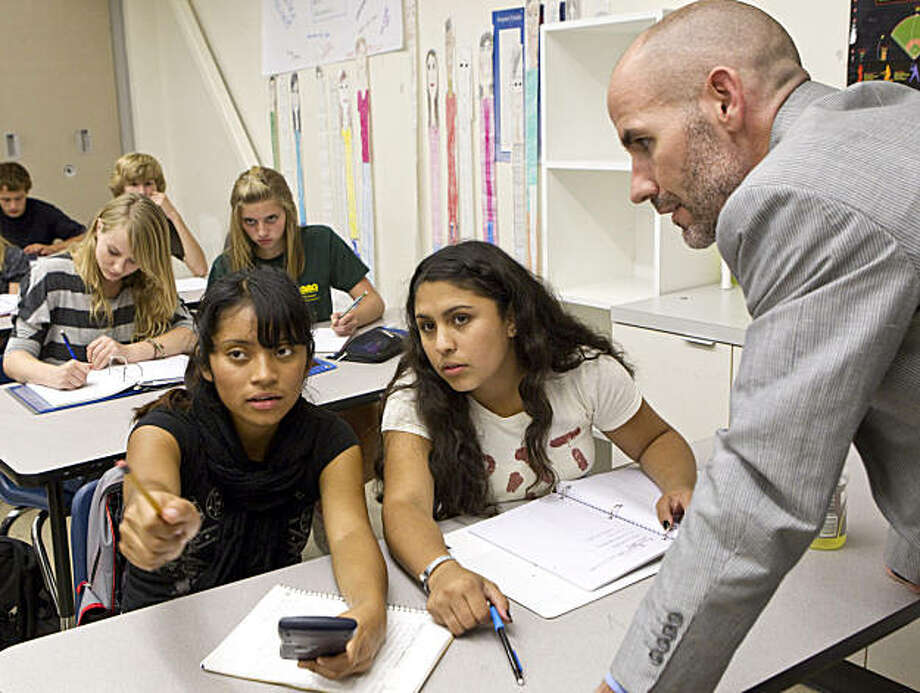 Summit Preparatory Charter High School Executive Director Todd Dickson helps Arleni Barrios (left) and Adriana Corrales while observing their science class at the school in Redwood City, Calif., on Friday, September 24, 2010. Photo: Laura Morton, Special To The Chronicle