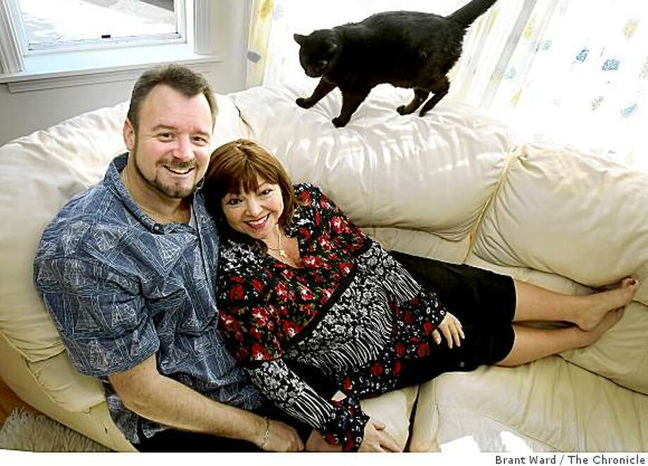 David Nottage III with wife Joanne Pappas-Nottage and their 12 year old cat Tasha in their San Francisco home Sunday February 1, 2009. Photo: Brant Ward, The Chronicle