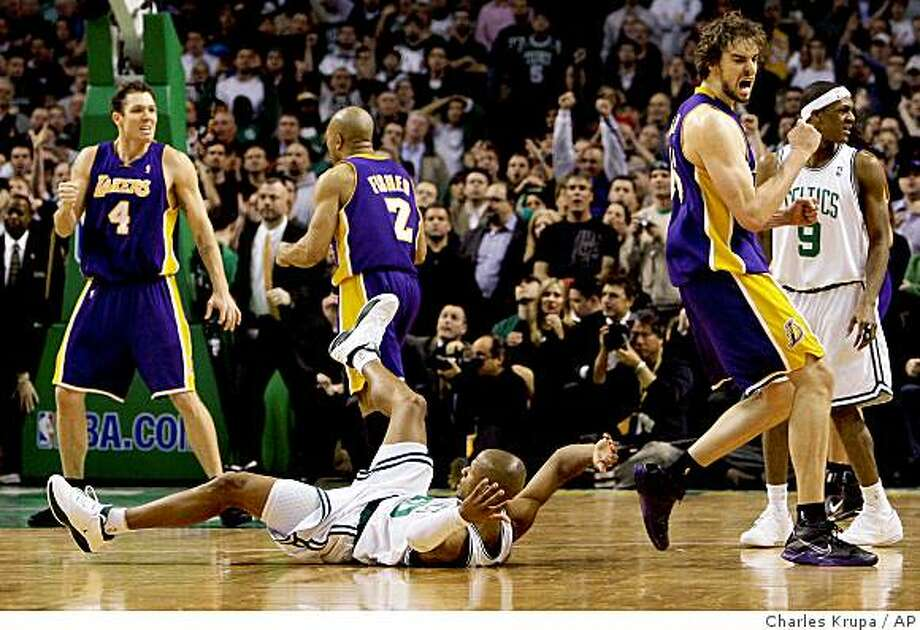 Los Angeles Lakers forward Pau Gasol, right, of Spain, pumps his fist while Boston Celtics guard Ray Allen hits the floor after missing a shot at the buzzer in overtime of an NBA basketball game in Boston, Thursday Feb. 5, 2009. The Lakers beat the Celtics 110-109. At left is Lakers forward Luke Walton. (AP Photo/Charles Krupa) Photo: Charles Krupa, AP