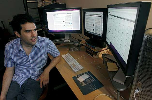 Techmeme website founder Gabe Rivera works in his home office in San Francisco, Calif., on Friday, Sept. 17, 2010 and will add a fourth computer monitor to his array soon. Rivera's technology news aggregator site celebrated its fifth anniversary earlier this month. Photo: Paul Chinn, The Chronicle