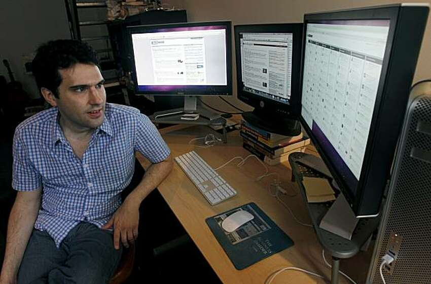 Techmeme website founder Gabe Rivera works in his home office in San Francisco, Calif., on Friday, Sept. 17, 2010 and will add a fourth computer monitor to his array soon. Rivera's technology news aggregator site celebrated its fifth anniversary earlier this month.