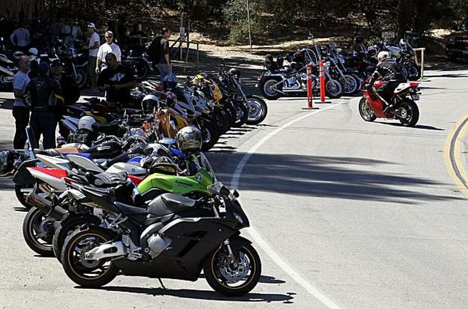 In this photo taken Sept. 4, 2010, motorcyclists line up their bikes at the Rock Shop Agoura Hills, Calif. The bill, passed this week by the state Senate, makes it a crime to operate a motorcycle that fails to meet federal noise-emission control standards. It targets motorcyclists who illegally remove emissions control devices in their bikes' exhaust system. Photo: Chris Carlson, AP