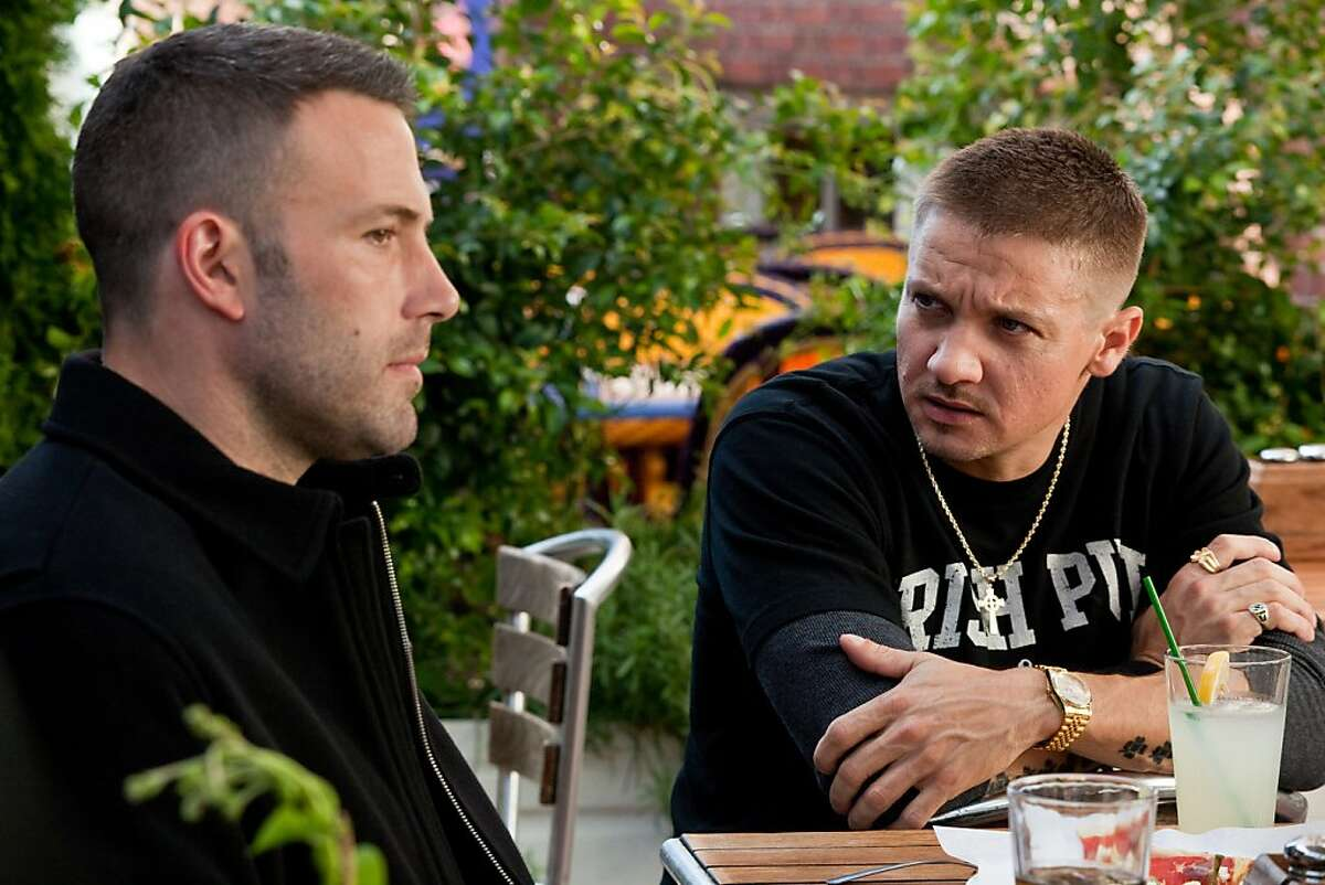 Ben Affleck, left, as Doug MacRay, and Jeremy Renner, as Jem Coughlin, star in the crime drama