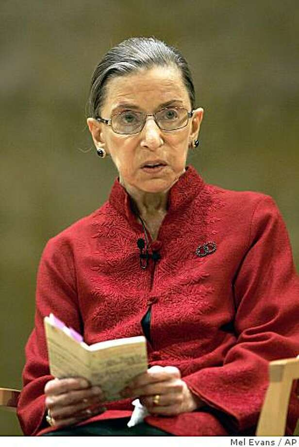 ** FILE ** In this Oct. 23, 2008 file photo, Supreme Court Justice Ruth Bader Ginsburg reads from a small book version of the U.S. Constitution while talking about constitutional law in Princeton, N.J.  Ginsburg has been hospitalized for surgery for pancreatic cancer. (AP Photo/Mel Evans, File) Photo: Mel Evans, AP