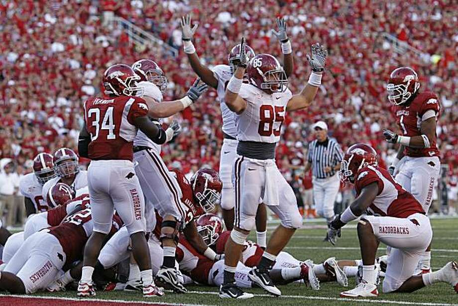 FAYETTEVILLE - SEPTEMBER 25: Alabama Crimson Tide players celebrate after Mark Ingram (not pictured) scored the game winning touchdown against the Arkansas Razorbacks at Donald W. Reynolds Razorback Stadium on September 25, 2010 in Fayetteville, Arkansas.Alabama won 24-20. Photo: Joe Robbins, Getty Images