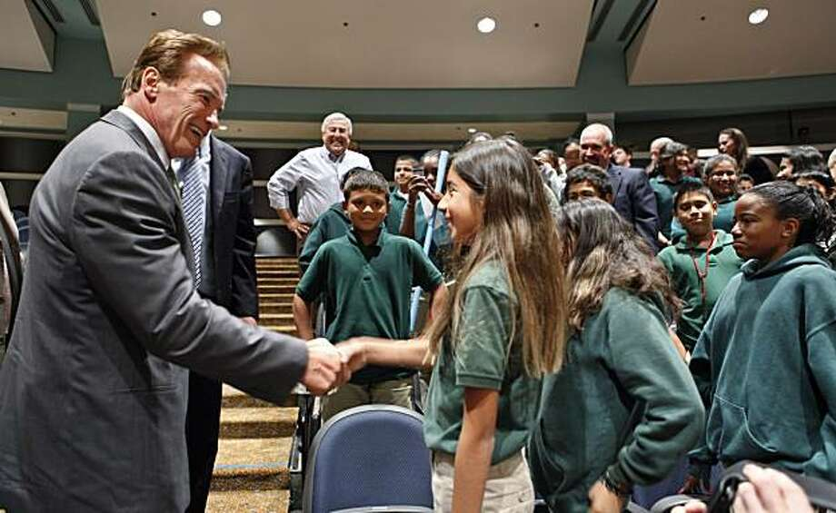 Gov. Arnold Schwarzenegger, left, shakes hands with students from Beechwood School in Menlo Park, Calif., after he spoke at the Commonwealth Club in Santa Clara, Calif., Monday, Sept. 27, 2010. Schwarzenegger is blasting the oil companies that are tryingto undermine California's global warming law, saying they are motivated purely by greed. Photo: Paul Sakuma, Associated Press