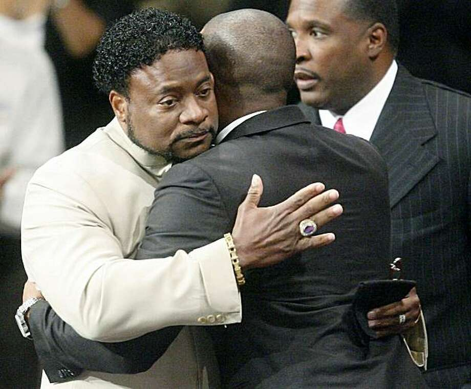 LITHONIA, GA - SEPTEMBER 26:  Bishop Eddie Long (L) embraces a friend, at the New Birth Missionary Baptist Church September 26, 2010 in Atlanta, Georgia.  Bishop Eddie Long, the pastor of a Georgia megachurch was accused of sexual coersion by three men whom were members of the New Birth Missionary Church. Long has said that he denies all the allegations and that all people must face painful and distasteful situations.  (Photo by John Amis-Pool/Getty Images) *** BEST PIX *** Photo: Pool, Getty Images
