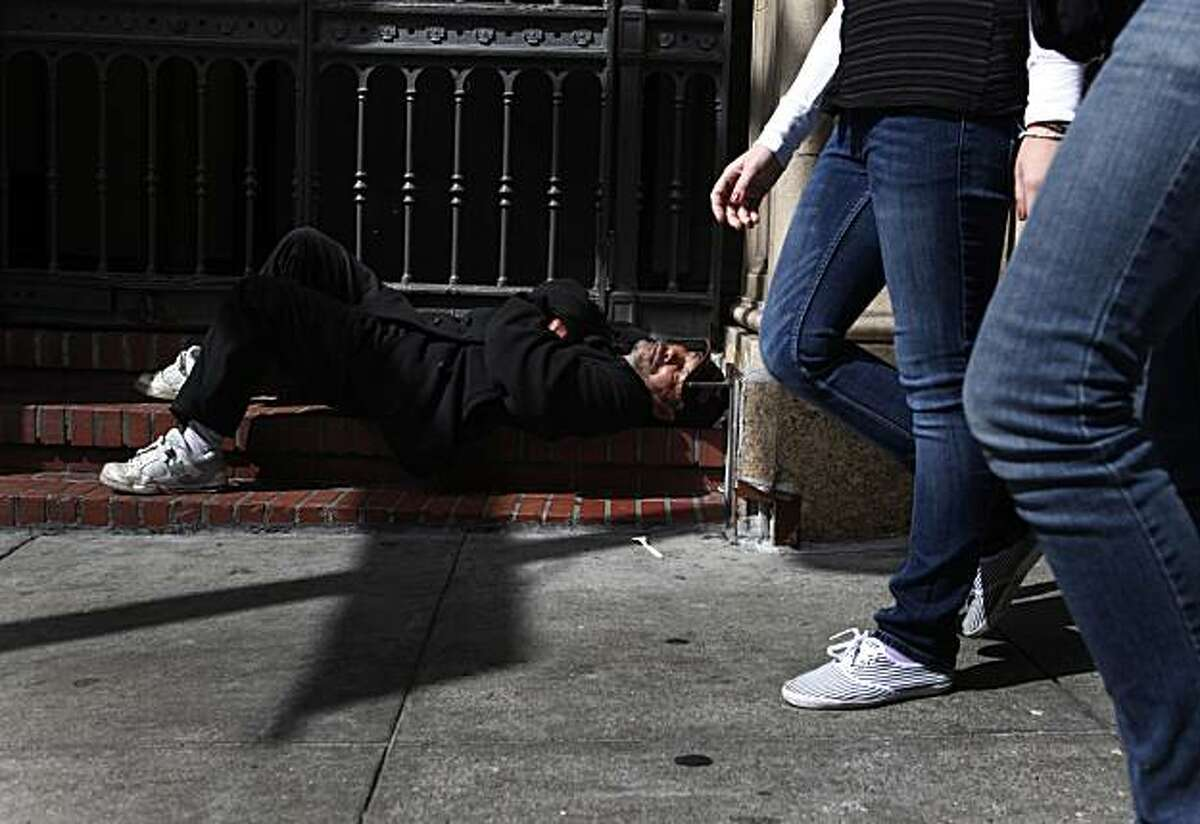 On the day the U.S. Census Bureau announced the start of a three day count of the city's homeless population, Rafael Bamba, 55, who has been homeless for the past 10 years, sleeps on the steps of Glide Memorial Church on Tuesday March 30, 2010 in San Francisco, Calif.