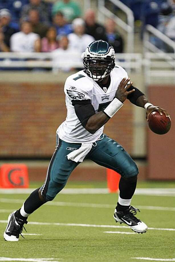 FILE - This Sept. 19, 2010, file photo shows Philadelphia Eagles quarterback Michael Vick (7) scrambling out of the pocket in an NFL football game against the Detroit Lions,  in Detroit. Eagles coach Andy Reid says Kevin Kolb will be the starting quarterback at Jacksonville on Sunday, despite a pair of impressive performances by fill-in Michael Vick. Photo: Rick Osentoski, AP