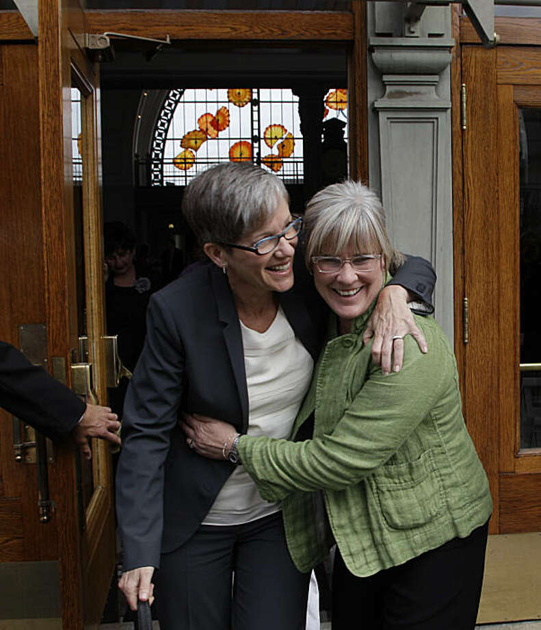 Margaret Witt, right, and her partner, Laurie McChesney, left, celebrate as they leave the federal courthouse in Tacoma, Wash., Friday, Sept. 24, 2010. A federal judge ruled Friday that Witt, a flight nurse discharged from the Air Force for being gay, should be given her job back as soon as possible. Photo: Ted S. Warren, AP