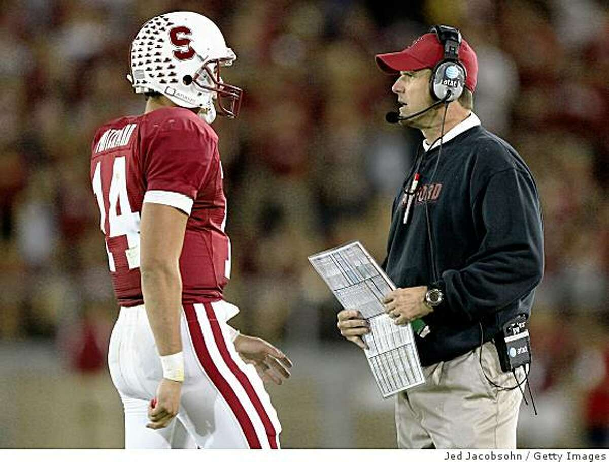 Stanford head coach Jim Harbaugh talks with QB Tavita Pritchard near the end of the game against USC at Stanford Stadium on November 15, 2008 in Stanford, California.