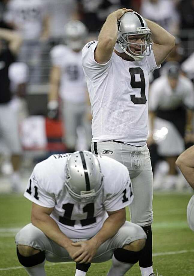 Oakland Raiders' Sebastian Janikowski, front, and Shane Lechler (9) react after Janikowski missed a field goal as time expired in an NFL football game against the Arizona Cardinals on Sunday, Sept. 26, 2010, in Glendale, Ariz. The Cardinals won 24-23. Photo: Matt York, AP