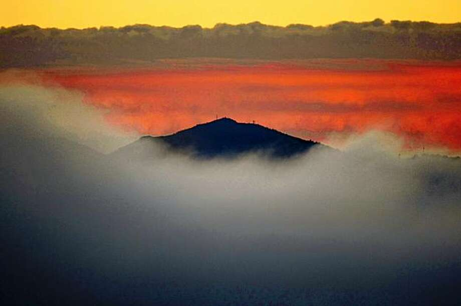 Heavy fog covers the Bay Area in different layers of hue leaving only the tallest peak of Mount Diablo visible from Hawk hill in the Marin Headlands just before sunrise on Tueday, October 28, 2008. Photo: Frederic Larson, The Chronicle