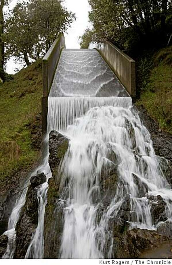 Water from Phoenix Lake, part of the Mount Tamalpais Municipal Water District, runs over its spillway in January 2008. Photo: Kurt Rogers, The Chronicle