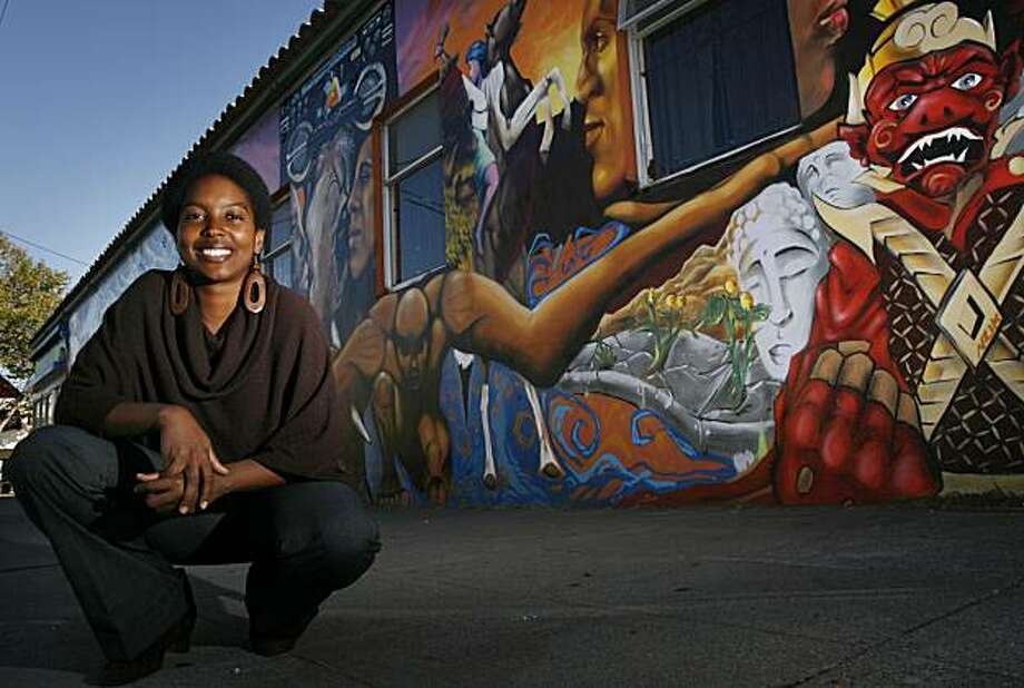 Nikki Henderson became the executive director of People's Grocery at the Oakland Green Arts & Media Center in Oakland, Calif. on Monday, Sept. 20, 2010. The artist of the murals that wrap around the building is Desi Wome, who also works at the center with the Community Rejuvenation Project. Photo: Kirsten Aguilar, The Chronicle