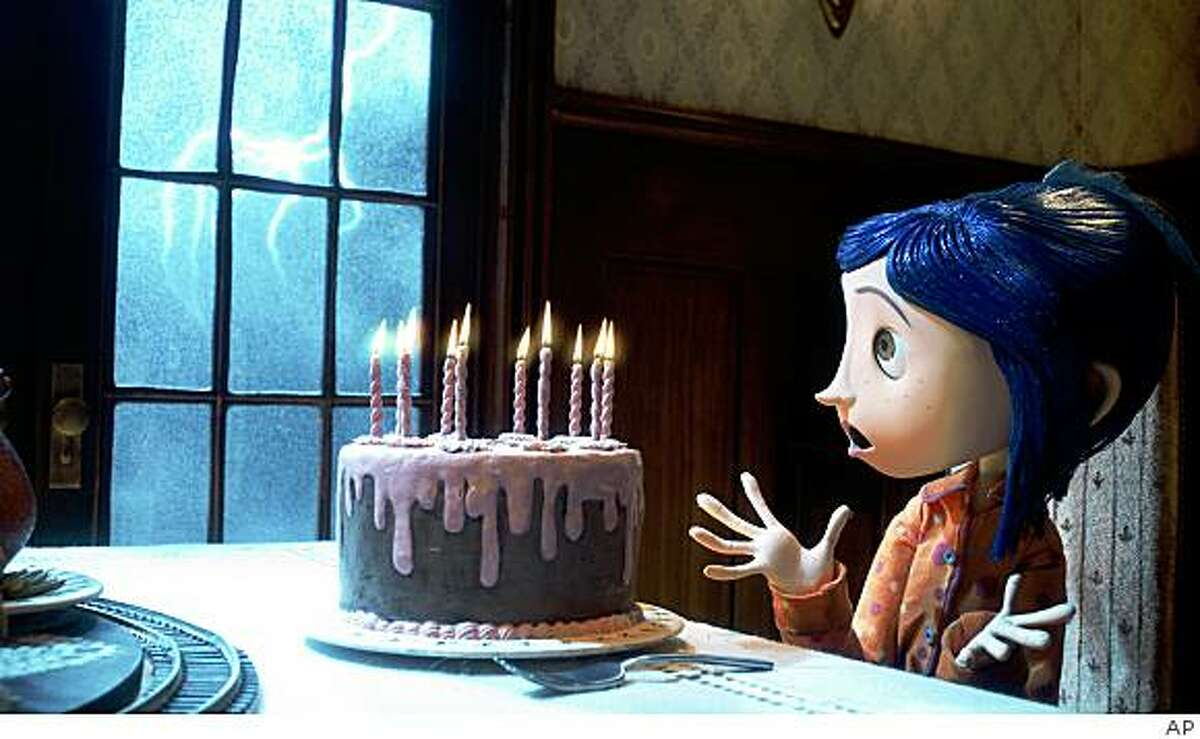 """In this image released by Focus Features, the character Coraline, is shown from the animated film, """"Coraline."""" (AP Photo/Focus Features) ** NO SALES **"""
