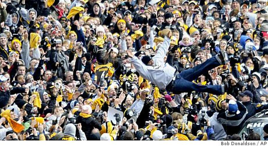 Pittsburgh Steelers safety Ryan Clark leaps in to the crowd during their Super Bowl victory parade in Pittsburgh, Tuesday, Feb. 3 2009.  The Steelers beat the Arizona Cardinals 27-23 in football's Super Bowl XLIII on Feb. 1 in Tampa, Fla. (AP Photo/Post-Gazette, Bob Donaldson) ** MONESSEN OUT, KITTANNING OUT, CONNELLSVILLE OUT, GREENSBURG OUT, TARENTUM OUT, NORTH HILLS NEWS RECORD OUT, BUTLER OUT, PITTSBURGH OUT. MAGS OUT, NO SALES ** Photo: Bob Donaldson, AP