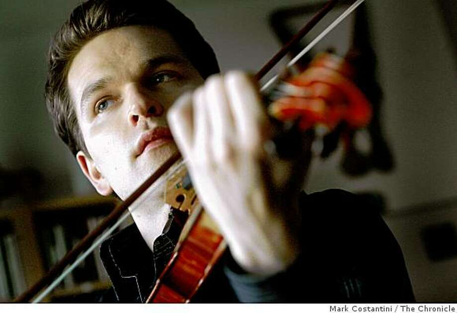 Mads Tolling, a Danish fiddle prodigy who's won two Grammys as a member of Turtle Island String Quartet  practices in Albany, Calif., on Wednesday January 28, 2009. Photo: Mark Costantini, The Chronicle