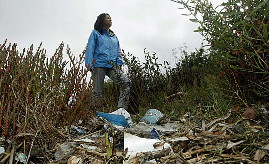 Felicia Madsen Chief Strategy Officer for Save The Bay walks the banks of Damon Slough in Oakland.  It is one of the most trash-filled waterways in the Bay.  Save the Bay along with other organizations plans on taking part in Coastal Cleanup Day this Saturday.  Photo was taken Tuesday, Sept. 21, 2010. Photo: Lance Iversen, The Chronicle