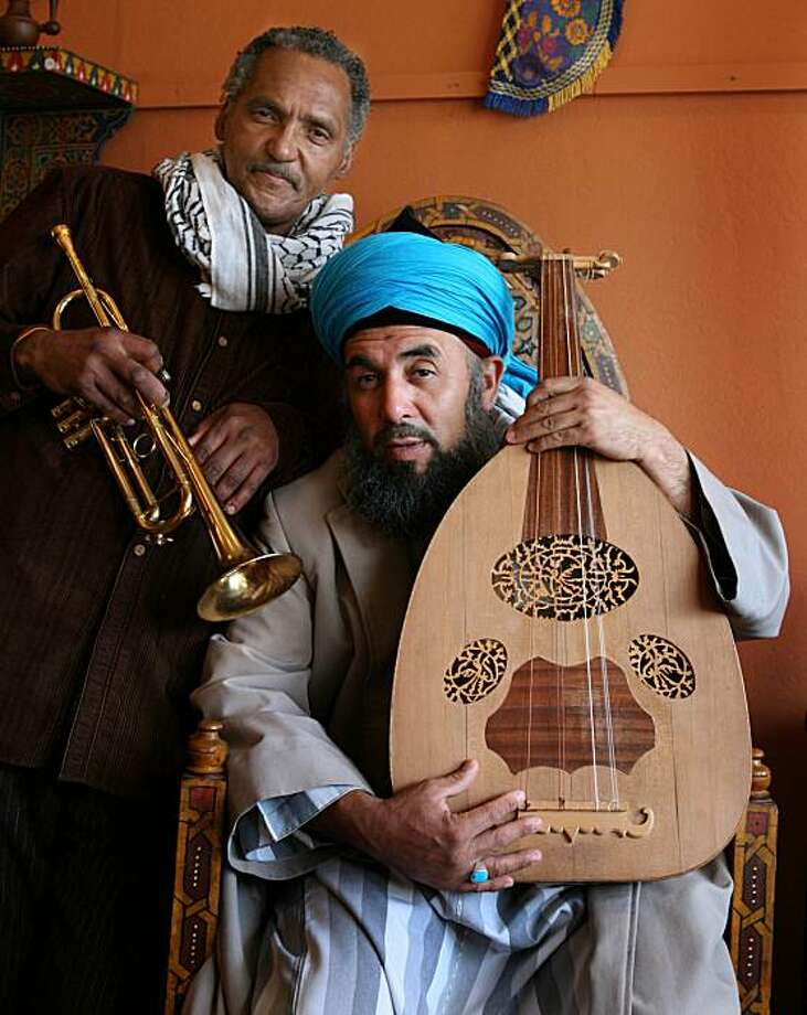Trumpeter Khalil Saheed, left and oud player Yassir Chadly, the leaders of the Mo' Rockin' Project, an Oakland band that plays North African and North American jazz music pose for a photograph on April 4, 2008 in Berkeley, Calif.  Photo by Mark Costantini  /  San Francisco Chronicle. Photo: Mark Costantini, SFC