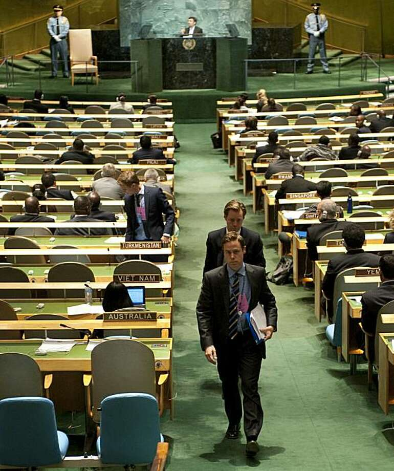 Diplomats from the the Swedish delegation walk out as Iranian President Mahmoud Ahmadinejad (background) addresses the 65th session of the General Assembly September 23, 2010 at the United Nations in New York.  The United States led an enraged western walkout of the UN General Assembly after Ahmadinejad said most people believed the US government orchestrated the September 11 attacks. The British and other European Union delegations quickly followed after the Iranian leader said most Americans also believed their government was involved in the 2001 attacks. Photo: Don Emmert, AFP/Getty Images