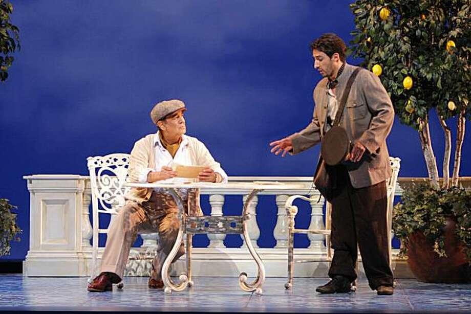 """Placido Domingo (Pablo Neruda), Charles Castronovo (Mario Ruoppolo) in, """"Il Postino."""" Photo: Robert Millard, LA Opera"""