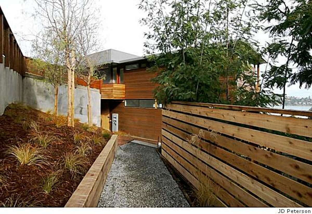 Exterior walkway and landscaping of two new green homes built on top oc eathe in the old neighborhood abovve downtown Sausalito. Architect/developer couple will live in top unit -- the one below is on the market for $1.85 million.