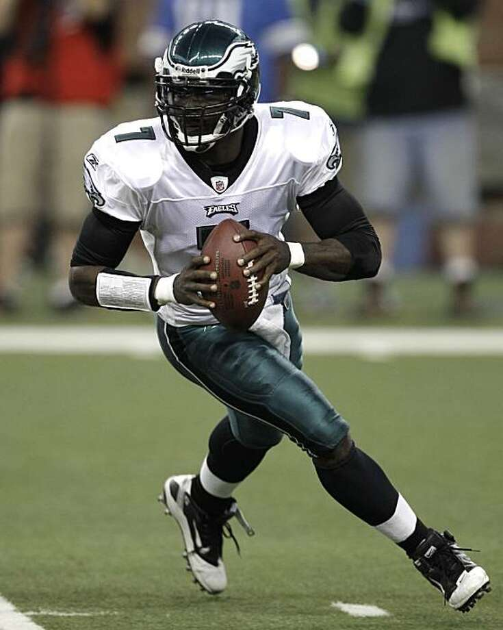Philadelphia Eagles quarterback Michael Vick rolls out against the Detroit Lions during the first half of an NFL football game in Detroit,  Sunday, Sept. 19, 2010. Photo: Paul Sancya, AP