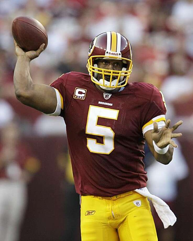 Washington Redskins quarterback Donovan McNabb (5) throws a pass against the Houston Texans during the second half of an NFL football game, Sunday, Sept. 19, 2010, in Landover, Md. The Texans won 30-27 in overtime. Photo: Rob Carr, AP