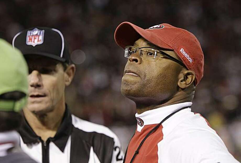 San Francisco 49ers coach Mike Singletary stands near an official late in the NFL football game against the New Orleans Saints in San Francisco on Monday, Sept. 20, 2010. The Saints won 25-22. Photo: Paul Sakuma, AP