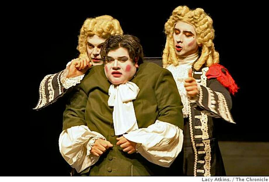 "Raul Roman (left) Javier Medina and Gaston Yanes , cast members perform in a dress rehearsal of ""Monsters and Prodigies"" by Teatro de Ciertos Habitantes at Yerba  Buena Center for the Arts Novellus Theater, Wed. Feb. 4, 2009, in San Francisco, Calif. Photo: Lacy Atkins,, The Chronicle"