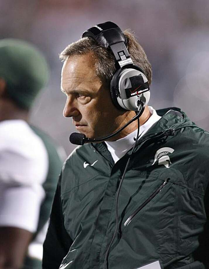 Michigan State coach Mark Dantonio is shown during a timeout in the first quarter of a 34-31 overtime win over Notre Dame in an NCAA college football game, Saturday, Sept. 18, 2010, in East Lansing, Mich. Dantonio had a mild heart attack and was hospitalized Sunday morning, shortly after calling an audacious fake field goal to beat Notre Dame in overtime. The 54-year-old Dantonio had surgery to put a stent in a blocked blood vessel leading to the heart. He's expected to remain in the hospital a few more days, and offensive coordinator Don Treadwell will lead the team during Dantonio's indefinite absence. Photo: Al Goldis, AP