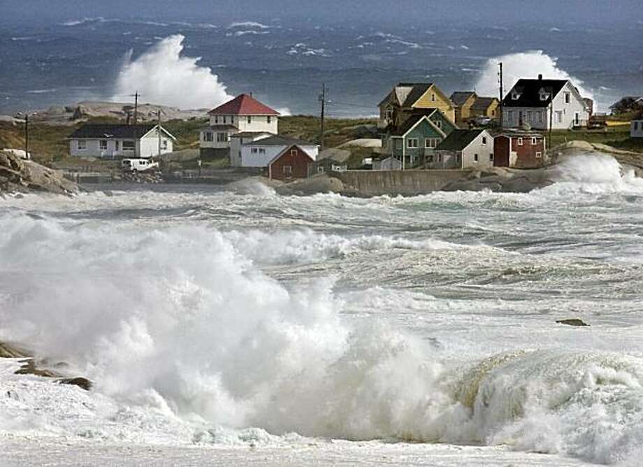 Waves from hurricane Earl pound the coast at Peggys Cove, Nova Scotia, Saturday, Sept. 4, 2010. Police closed roads leading to the iconic lighthouse as a safety precaution, keeping the curious away from the dangerous rocks. Heavy rain, high winds and surfbattered the region. Photo: Andrew Vaughan, AP