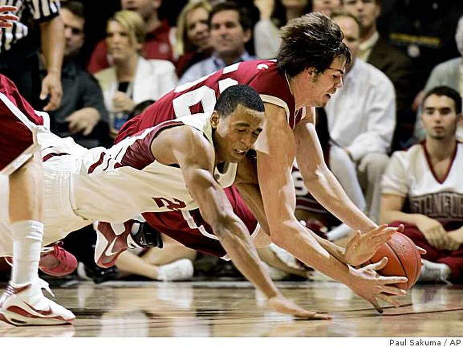 Stanford forward Josh Owens (24) and Washington State forward Caleb Forrest, behind, dive for the ball in the second half of an NCAA college basketball game in Stanford, Calif., Thursday, Feb. 5, 2009. Stanford defeated Washington State 65-54. (AP Photo/Paul Sakuma) Photo: Paul Sakuma, AP
