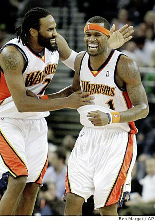 Golden State Warriors' Ronny Turiaf, left, congratulates teammate Stephen Jackson after Jackson scored his first career triple-double during the second half of an NBA basketball game against the Phoenix Suns Wednesday, Feb. 4, 2009, in Oakland, Calif. (AP Photo/Ben Margot) Photo: Ben Margot, AP