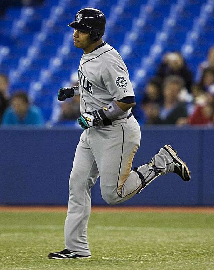 Seattle Mariners' Jose Lopez, rounds the bases after hitting a two-run home run against the Toronto Blue Jays during eighth-inning AL baseball game action in Toronto on Wednesday, Sept. 22, 2010. Photo: Nathan Denette, AP