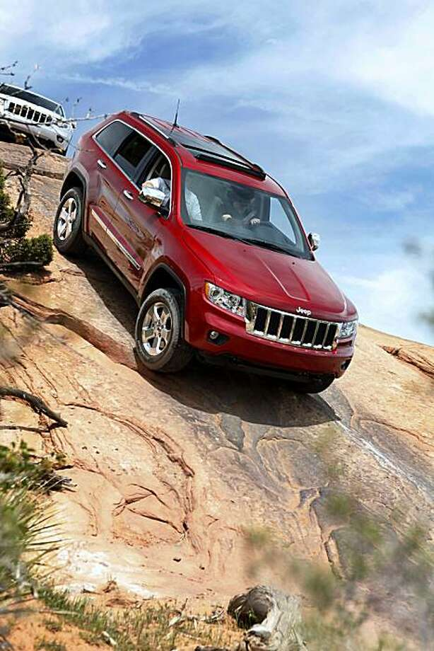 Delivering top-notch driving quality on- and off-road is Jeep's goal with its new-generation 2011 Grand Cherokee, which is redesigned and rides on a new platform. It's available in three basic models -- Laredo (E and X), Limited (shown) and new-designation Overland. Pricing (4x2/4x4) starts at $30,995/$32,995 for the Laredo, $37,495/$39,995 for the Limited and $39,495/$42,995 for the Overland. Photo: Courtesy Of Jeep