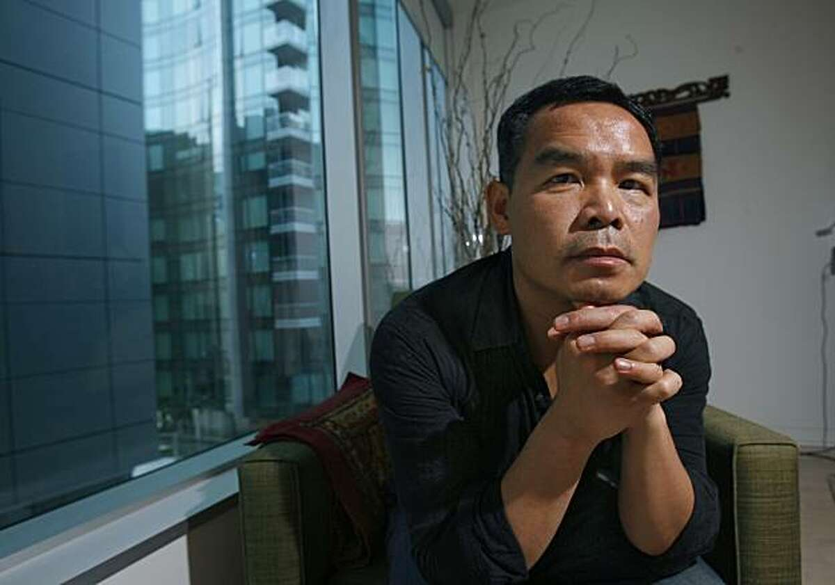 San Francisco local Andrew Lam is pictured in his home north of Rincon Hill. Lam makes a living in the city as a journalist, essayist and radio commentator, and releases his new book,