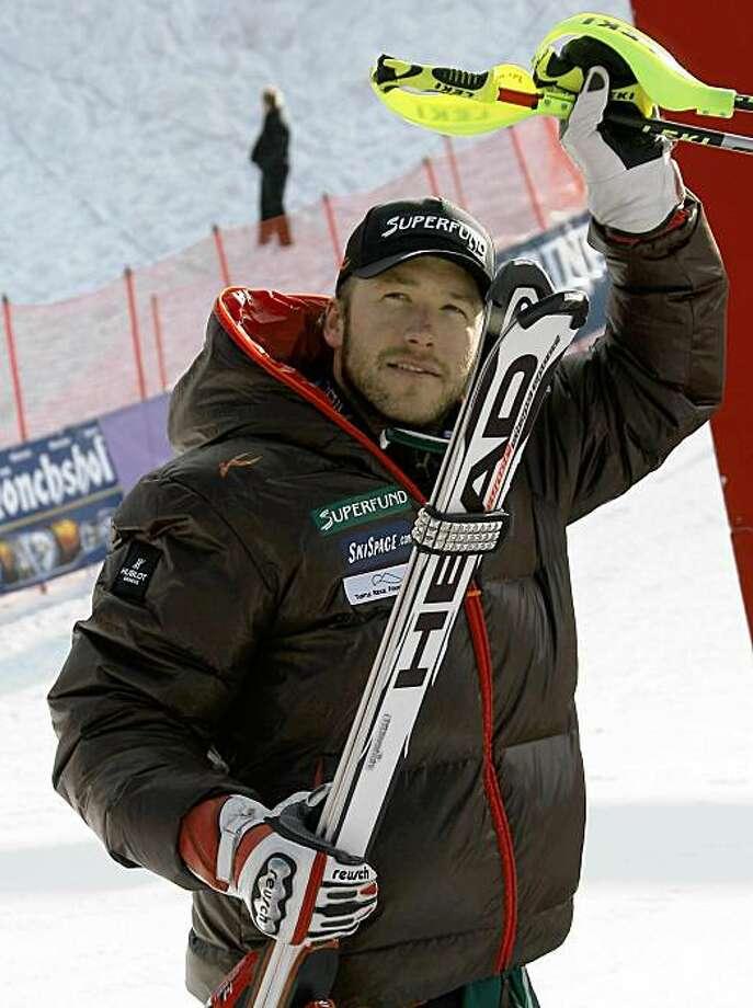 Bode Miller, of the United States, salutes after taking sixth place in an alpine ski, men's World Cup slalom race, in Garmisch Partenkirchen, Germany, Sunday, Feb. 1, 2009. (AP Photo/Enrico Schiavi) Photo: Enrico Schiavi, AP
