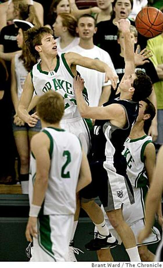 Drake's Dillon Sabia (left) blocked a shot by Marin Catholic's Austin Renk under the basket. Marin Catholic mens basketball team visits Sir Francis Drake High in San Anselmo, CA Tuesday February 3, 2009. Photo: Brant Ward, The Chronicle