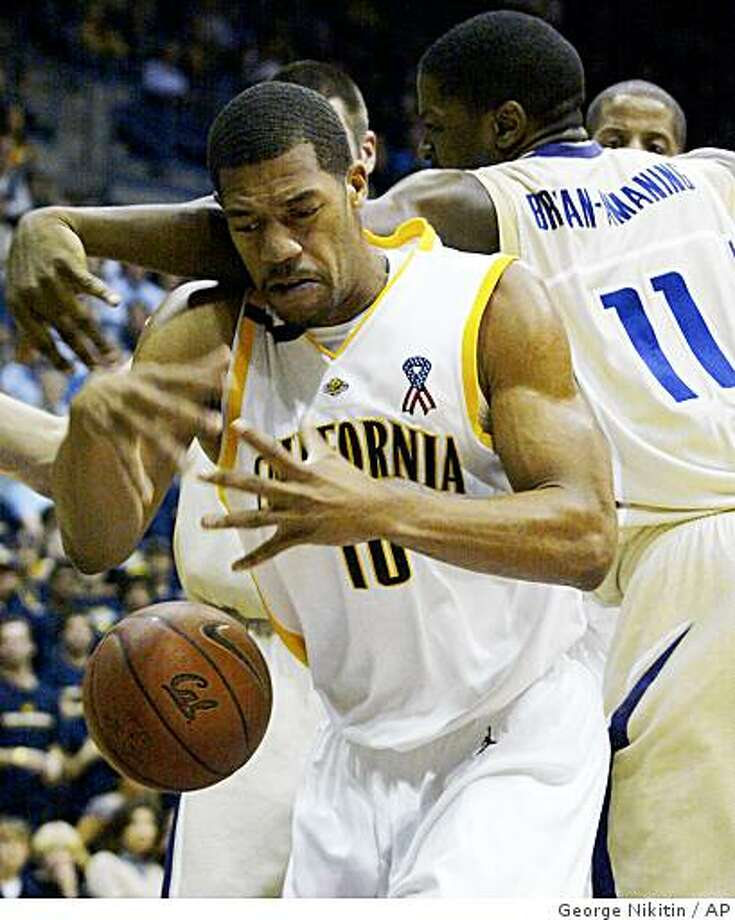 Washington's Matt Bryan-Amaning (11), knocks the ball away from California's Jamal Boykin during the first half of an NCAA college basketball game, Thursday, Feb. 5, 2009 in Berkeley, Calif.  (AP Photo/George Nikitin) Photo: George Nikitin, AP