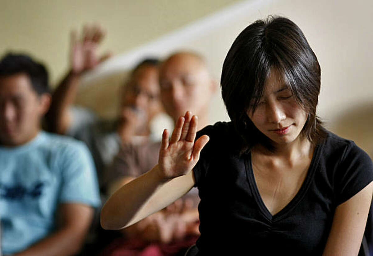 Dr. Joan Jie-eum Jeung prays during sunday service at the New Hope Covenant Church, Sunday,August 29, 2010, in Oakland, Calif.