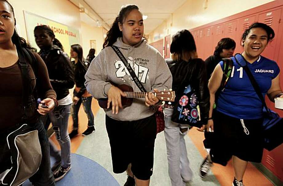 10th grader, Mu Savea plays her Ukulele while walking to her next class, on Tuesday Sept. 14, 2010, at the June Jordan School of Equity in San Francisco, Calif. Photo: Michael Macor, The Chronicle