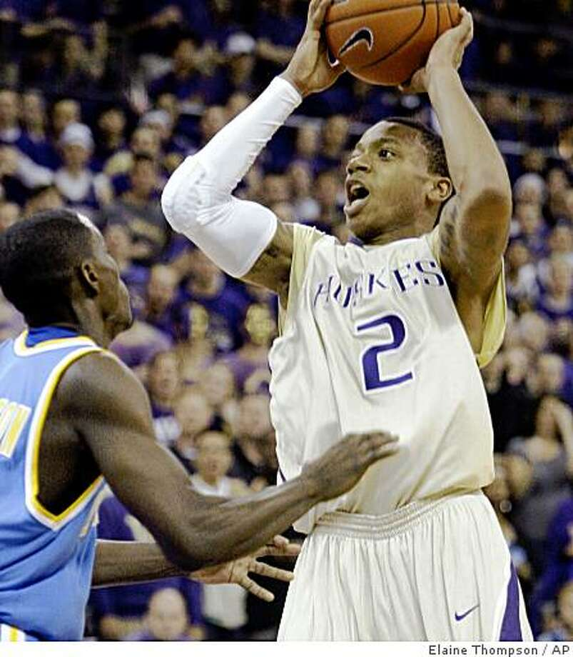 Washington's Isaiah Thomas (2) shoots over UCLA's Darren Collison Saturday, Jan. 24, 2009, during the second half of an NCAA basketball game in Seattle. Washington won 86-75. (AP Photo/Elaine Thompson) Photo: Elaine Thompson, AP