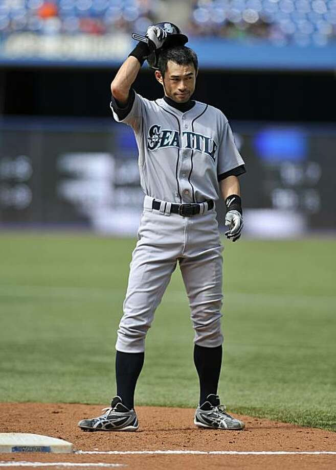 TORONTO - SEPTEMBER 23:   Ichiro Suzuki #51 of the Seattle Mariners tips his hat to the crowd of hitting his 200th hit of the season during game action against the Toronto Blue jays September 23, 2010 at Rogers Centre in Toronto, Ontario, Canada. Photo: Brad White, Getty Images
