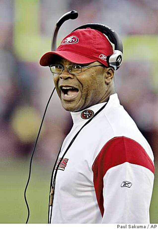 San Francisco 49ers head coach Mike Singletary coaches from the sidelines in the fourth quarter of a game against the St. Louis Rams in San Francisco, Sunday, Nov. 16, 2008. The 49ers defeated the Rams 35-16. Photo: Paul Sakuma, AP