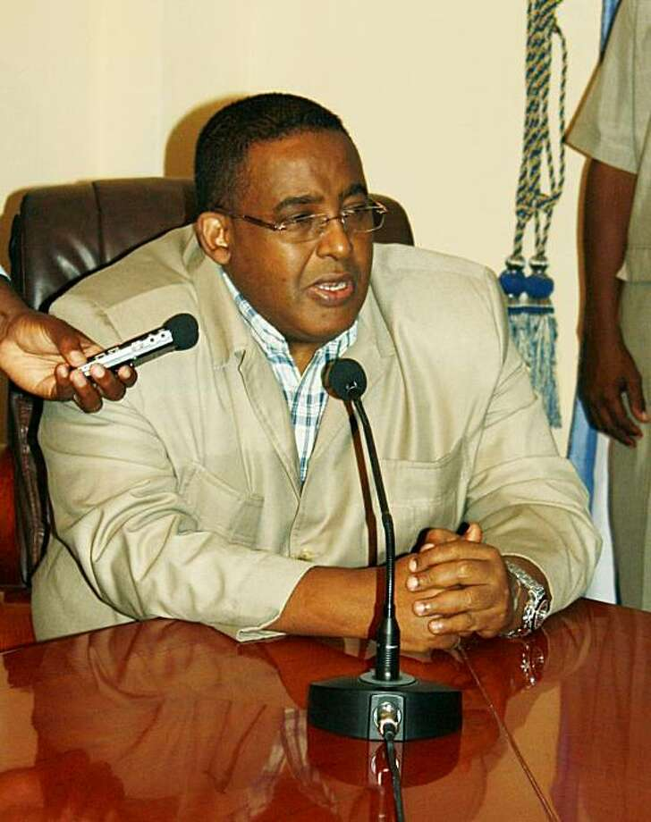 Somali Prime Minister Omar Abdirashid Sharmarke announces his resignation on September 21, 2010 after a weeks-long dispute with President Sharif Sheikh Ahmed. The long-brewing feud between the two principals resulted in Sharmarke's exit before a fully-fledged political crisis could blow up but left the embattled government in limbo as it struggled to fend off a fierce insurgency. Photo: Abdirashid Abdulle Abikar, AFP/Getty Images