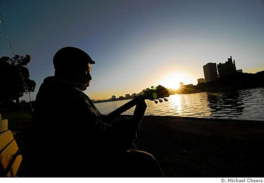 A photograph by D. Michael Cheers of guitarist Bobby Tucker at sunset by Lake Merritt in Oakland. Photo: D. Michael Cheers