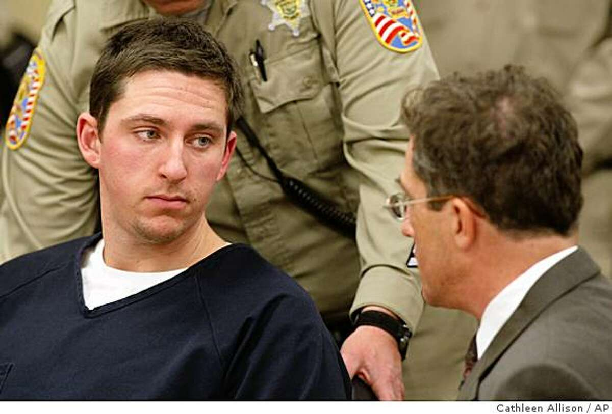 ** RETRANSMISSION TO CORRECT LEFT TO RIGHT ** Johannes Mehserle, left, talks with his attorney Christopher Miller in the East Fork Justice Court on Wednesday morning, Jan. 14, 2009, in Minden, Nev. Mehserle is being held on charges related to the New Year's day shooting of an unarmed man on an Oakland, Calif., train platform. Mehserle, 27, waived extradition to California early Wednesday during a brief court appearance in Minden, Nev., and was being held without bail on a warrant charging homicide. Douglas County Sheriff's Deputy Ron Mills is at left. (AP Photo/Cathleen Allison)